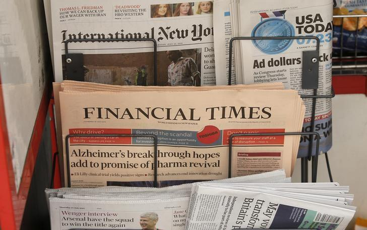 Copies of the Financial Times newspaper sit in a rack at a newsstand in London