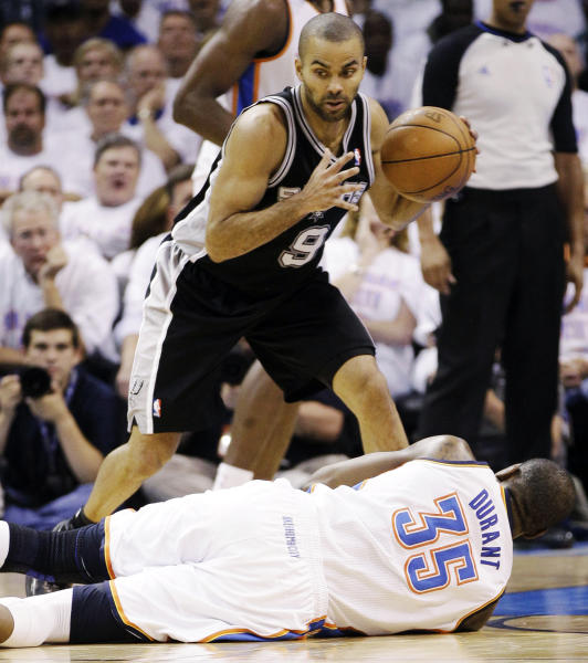 San Antonio Spurs point guard Tony Parker (9), of France, takes the ball downcourt past Oklahoma City Thunder small forward Kevin Durant (35) during the first half of Game 6 in the NBA basketball Western Conference finals, Wednesday, June 6, 2012, in Oklahoma City. (AP Photo/Eric Gay)