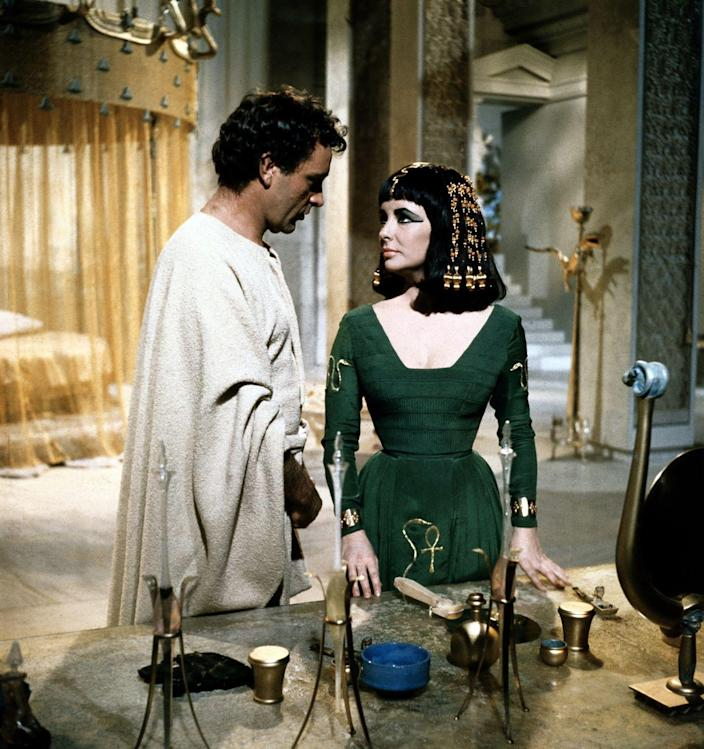 <p>Elizabeth Taylor and Richard Burton play the iconic roles in this historic film. Cleopatra, the Queen of Egypt, begins to have fantasies about ruling the world with Caesar. Then, she meets Marc Antony, a Roman statesman, and the two have an affair. Antony is forced to marry Octavia, which leaves Cleopatra devastated. They eventually reconcile, but their love story ended tragically. Believing that Cleopatra had killed herself, Antony stabbed himself with his sword. He was taken to Cleopatra upon learning that she was still alive. He died in her arms and Cleopatra also took her life.</p>