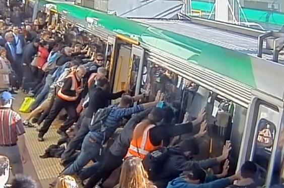 Perth commuters band together to push train off man who trapped leg in gap between carriage and platform (Getty)
