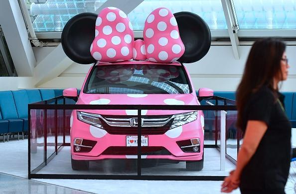 A woman walks past a display Minnie model of the 2018 Honda Odyssey at the 2017 LA Auto Show on November 29, 2017 in Los Angeles, California. (FREDERIC J. BROWN/AFP/Getty Images)