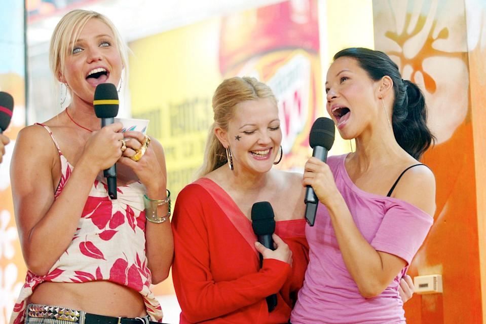 <p>The trio took the stage to sing in prime early-aughts 'fits during a visit to MTV's beloved <em>Total Request Live</em> in June 2003. </p>