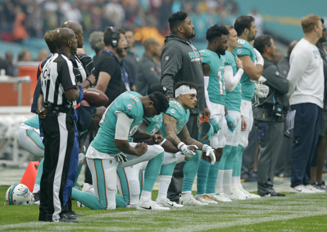 <p>Miami Dolphins players kneel down during the national anthem before the NFL game between the Miami Dolphins and the New Orleans Saints at Wembley Stadium on October 1, 2017 in London, England. (Photo by Henry Browne/Getty Images) </p>