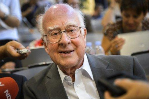 British physicist Peter Higgs smiles at a press conference on July 4, at the European Organization for Nuclear Research (CERN) offices in Meyrin near Geneva. After a quest spanning nearly half a century, physicists said on July 4 they had found a new sub-atomic particle consistent with the Higgs boson which is believed to confer mass