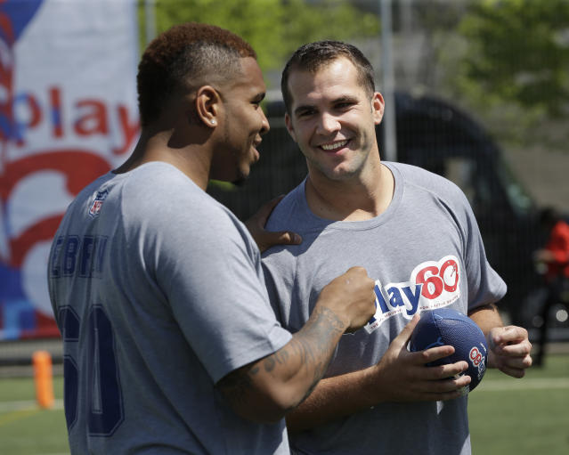 Central Florida's Blake Bortles, right, talks with North Carolina's Eric Ebron during an NFL football event in New York, Wednesday, May 7, 2014. The event was to promote Play 60, an NFL program which encourages kids to be active for a healthy life. (AP Photo/Seth Wenig)