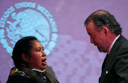 Jacinta Francisco (L), one of the three indigenous women who were wrongfully jailed for years, talks with Attorney General Raul Cervantes after a formal apology from the Attorney General's Office, in Mexico City, Mexico February 21, 2017. REUTERS/Carlos Jasso