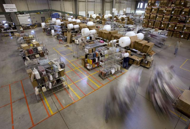 FILE - In this Friday, Nov. 29, 2008, file photo, carts full of merchandise ordered online are rolled to the main packing area for shipping at the Overstock.com warehouse, in Salt Lake City. Cyber Monday, coined in 2005 by a shopping trade group that noticed a spike in online sales on the Monday after Thanksgiving when people returned to their work computers, is the next in a line of days that stores are counting on to jumpstart the holiday shopping season. This year it is expected to be the biggest online shopping day of the year for the third year in a row. (AP Photo/Douglas C. Pizac)