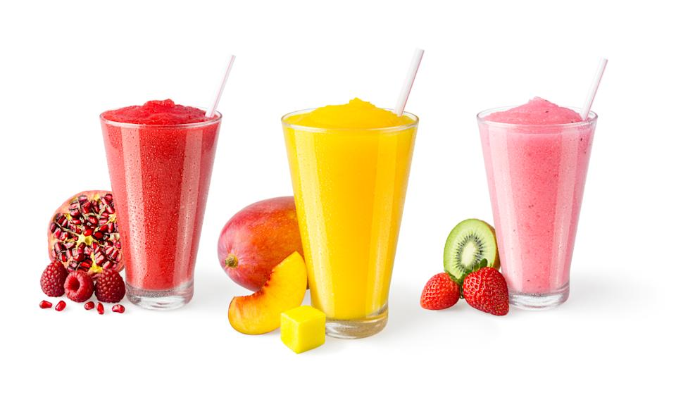 Close-Up Of Fruits And Juice Against White Background