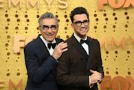 """""""Schitt's Creek,"""" a Canadian comedy about a privileged family forced to live in a rundown motel, failed to earn a single nomination in its first four years -- but won big at this year's Emmys -- seen here are winners Eugene Levy (L) and son Dan Levy"""
