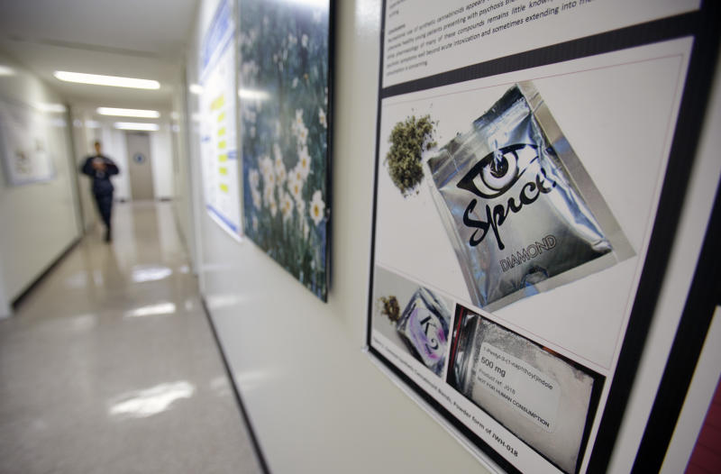 In this photo taken Tuesday, Dec. 6, 2011,  a poster warning of the effects of the drug known as 'spice' hangs on a wall at the Naval Hospital, in San Diego. The U.S. Navy has kicked out a record number of sailors and Marines this year for smoking synthetic marijuana and is seeing a dramatic jump in emergency room visits of its users, including some who babbled or hallucinated for eight days. (AP Photo/Gregory Bull)