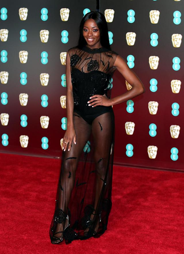 <p>The TV presenter wore the most raunchy look of the night: a nearly naked lace dress. <em>[Photo: Getty]</em> </p>