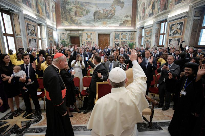 Former White House Press Secretary and Communications Director Sean Spicer takes a picture of Pope Francis, during a special audience at the Vatican August 27, 2017. (Osservatore Romano/Handout via Reuters)