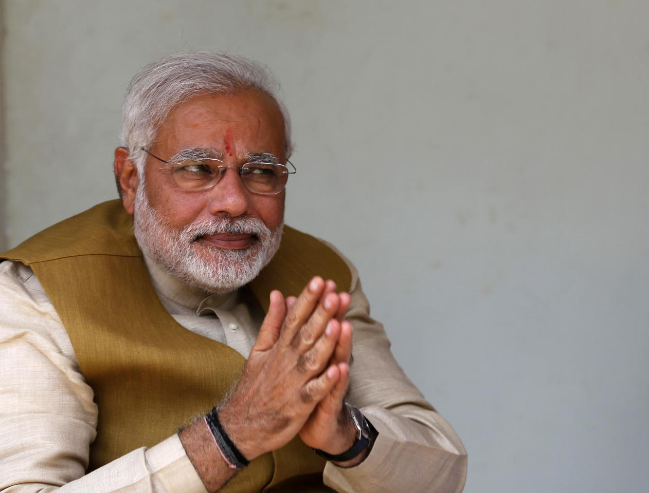 Hindu nationalist Narendra Modi, the prime ministerial candidate for India's main opposition Bharatiya Janata Party (BJP), gestures after seeking blessings from his mother Heeraben at her residence in Gandhinagar in the western Indian state of Gujarat May 16, 2014. Modi will be the next prime minister of India, with counting trends showing the pro-business Hindu nationalist and his party headed for the most resounding election victory the country has seen in 30 years. REUTERS/Amit Dave (INDIA - Tags: POLITICS ELECTIONS)