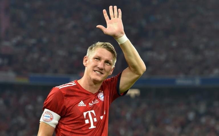 Ex-Germany captain Bastian Schweinsteiger waved goodbye to Bayern Munich on his final appearance in the famous red shirt on Tuesday in his testimonial at the Allianz Arena