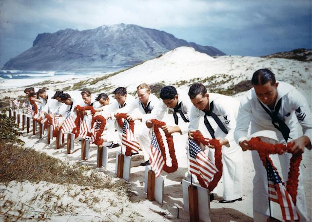 <p>Following Hawaiian tradition, Sailors honor men killed during the Japanese Pearl Harbor attack the previous year on Naval Air Station Kaneohe, Hawaii on May 31, 1942.The casualties had been buried on December 8, 1941. (U.S. Navy/National Archives/Handout via Reuters) </p>