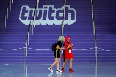 FILE PHOTO: Attendees walk past a Twitch logo painted on stairs during opening day of E3, the annual video games expo revealing the latest in gaming software and hardware in Los Angeles