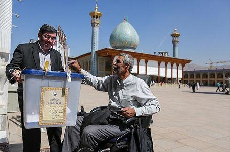 An Iranian man casts his vote during a second round of parliamentary elections, in Shiraz, Iran April 29, 2016. Farsnews.com/Handout via REUTERS