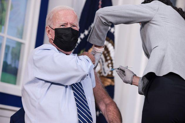President Joe Biden receives a third dose of the Pfizer/BioNTech Covid-19 vaccine at the White House on Monday. (Photo: Anna Moneymaker via Getty Images)