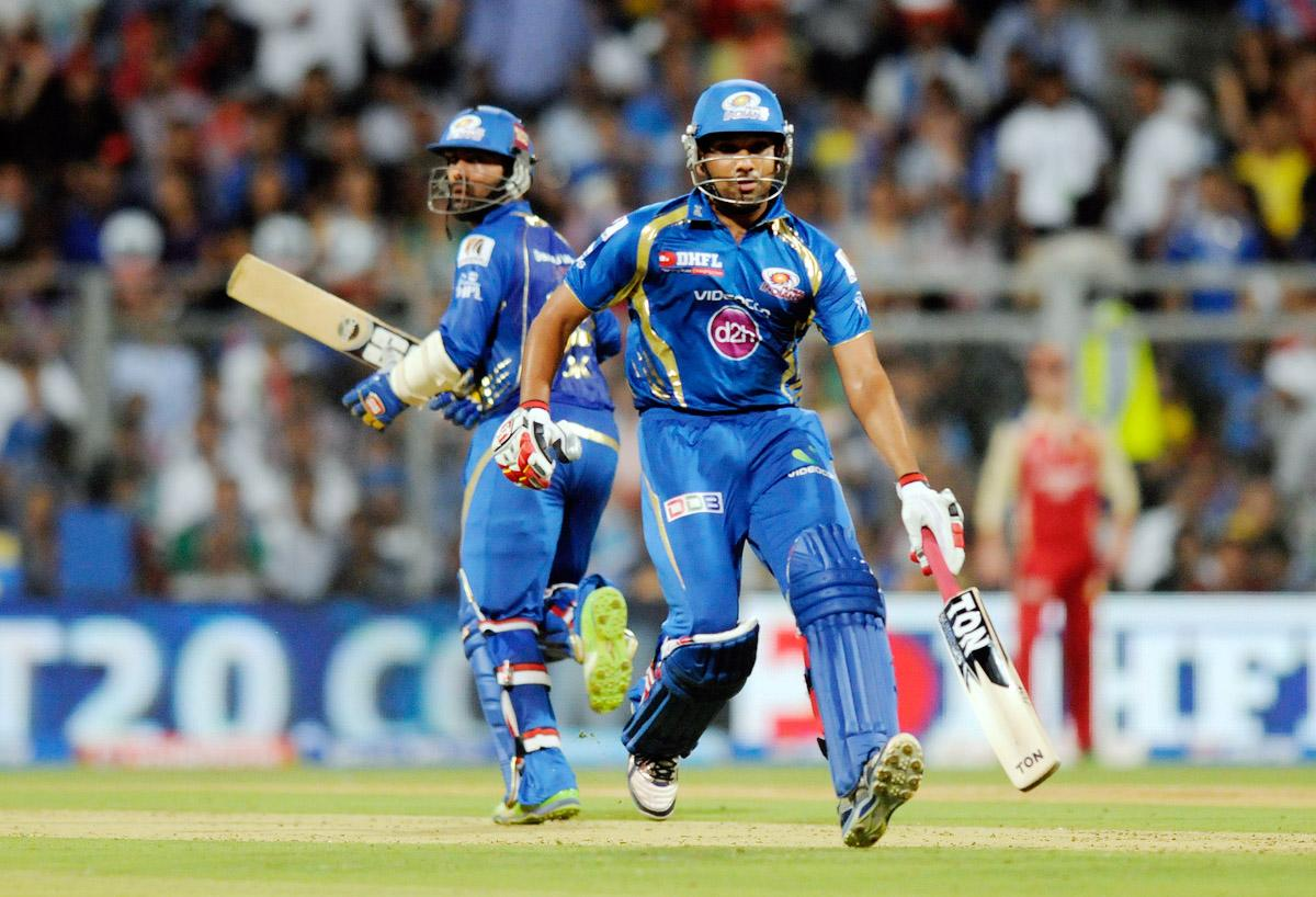 Dinesh Karthik of Mumbai Indians and Rohit sharma captain of Mumbai Indians run between the wickets  during match 37 of the Pepsi Indian Premier League ( IPL) 2013  between The Mumbai Indians and the Royal Challengers Bangalore held at the Wankhede Stadium in Mumbai on the 27th April 2013. (BCCI)