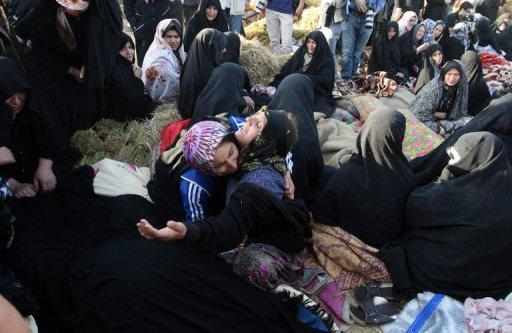 Iranians mourn for their loved ones in the village Baje-Baj, near the town of Varzaqan