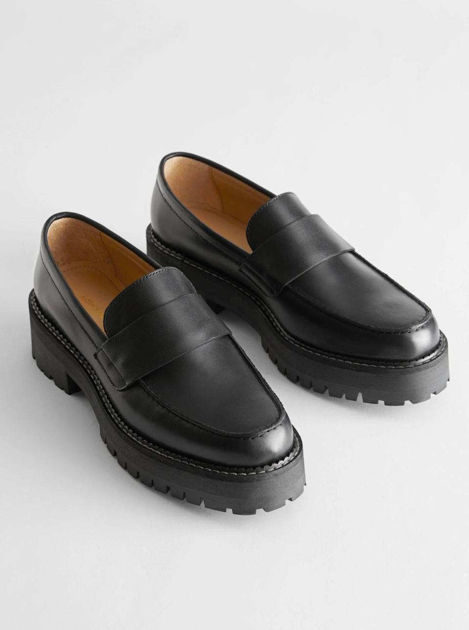 """$129, & Other Stories. <a href=""""https://www.stories.com/en_usd/shoes/flats/loafers/product.chunky-leather-penny-loafers-black.0965162001.html"""" rel=""""nofollow noopener"""" target=""""_blank"""" data-ylk=""""slk:Get it now!"""" class=""""link rapid-noclick-resp"""">Get it now!</a>"""