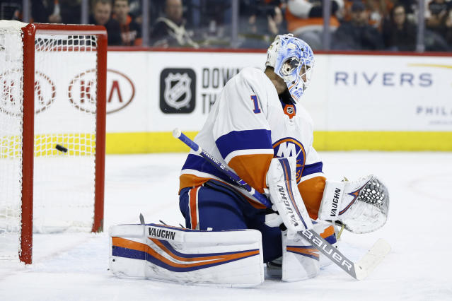 New York Islanders' Thomas Greiss cannot stop a goal by Philadelphia Flyers' Oskar Lindblom during the second period of an NHL hockey game, Saturday, Nov. 16, 2019, in Philadelphia. (AP Photo/Matt Slocum)