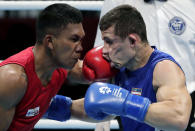 FILE - In this Friday, Aug. 31, 2018, file photo, Phillippines' Eumir Felix Marcial, left, and Uzbekistan's Israil Madrimov fight in their men's middleweight boxing semifinal at the 18th Asian Games in Jakarta, Indonesia. The International Boxing Association (AIBA) allowed professional boxers into the Olympics for the first time in Rio, but just three competed, and none did well. The COVID-affected qualification process and a general disinterest among top pros means there won't be any household names fighting in Tokyo, either. There are several pros in the field, but most, like Filipino middleweight Eumir Marcial, kept a foot in each boxing world during the pandemic. (AP Photo/Lee Jin-man, File)