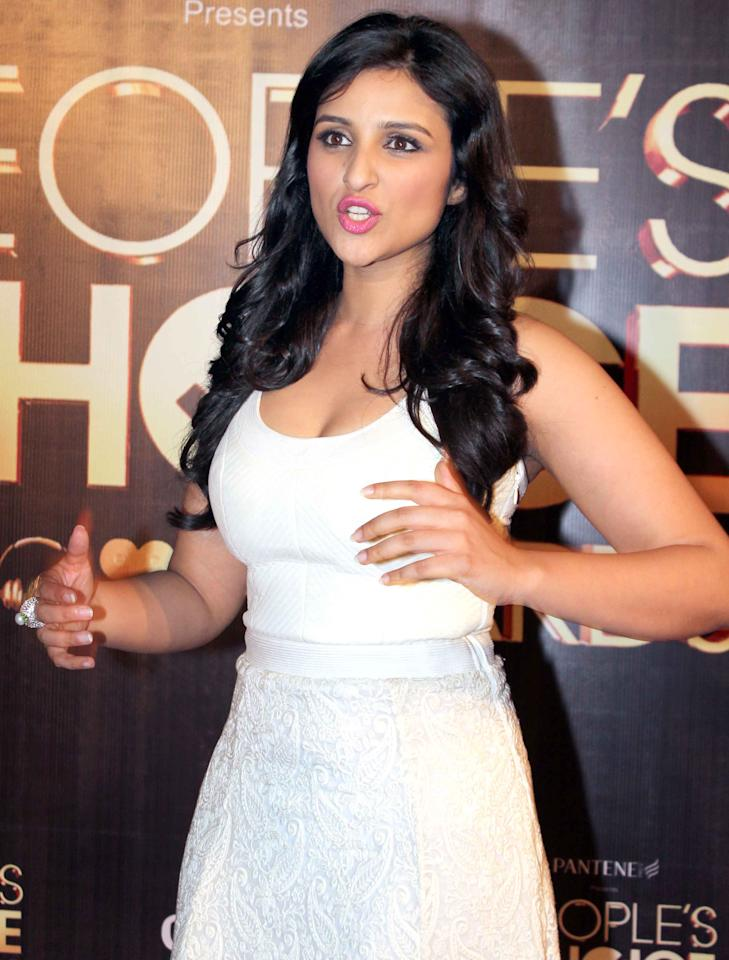 The super cute Parineeti here seems to be explaining something animatedly.