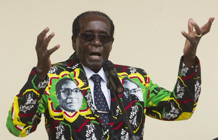 FILE - In this Saturday, Dec, 17, 2016 file photo, Zimbabwean President Robert Mugabe addresses people at an event before the closure of his party's 16th Annual Peoples Conference in Masvingo, south of the capital Harare. Mugabe celebrates his 93 birthday Tuesday, Feb. 21, 2017, with celebrations set for Saturday. (AP Photo/Tsvangirayi Mukwazhi, File)