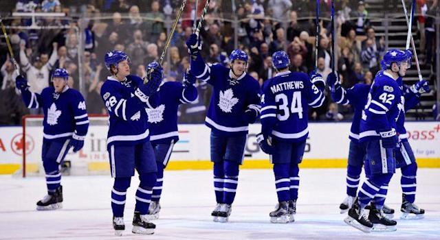 The Toronto Maple Leafs salute the crowd at Air Canada Centre after clinching a playoff berth in Saturday's win over the Pittsburgh Penguins. (THE CANADIAN PRESS/Frank Gunn)