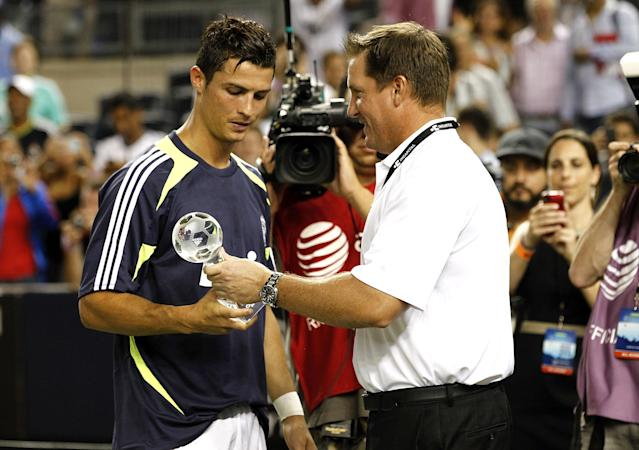 NEW YORK - AUGUST 08: Cristiano Ronaldo #7 of Real Madrid receives an award after a win over A.C. Milan in their match at Yankee Stadium on August 8, 2012 in New York City. (Photo by Jeff Zelevansky/Getty Images)