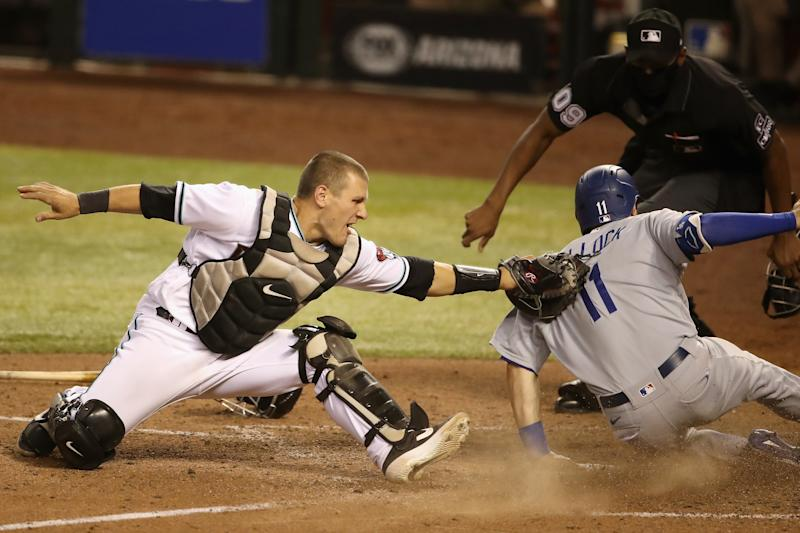 PHOENIX, ARIZONA - SEPTEMBER 08: Catcher Daulton Varsho #12 of the Arizona Diamondbacks attempts to tag A.J. Pollock #11 of the Los Angeles Dodgers as he safely slides into home plate to score a run during the 10th inning of the MLB game at Chase Field on September 08, 2020 in Phoenix, Arizona. (Photo by Christian Petersen/Getty Images)