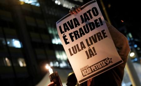 FILE PHOTO: A woman holds a sign during a protest against Brazil's Justice Minister Sergio Moro in Sao Paulo