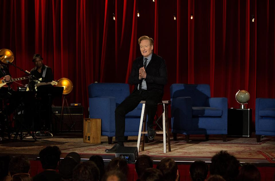 """Conan O'Brien, sitting on a stool in much the same way Johnny Carson did on his """"Tonight Show"""" finale, thanks """"Conan"""" staff and fans during the last episode of the TBS talk show."""