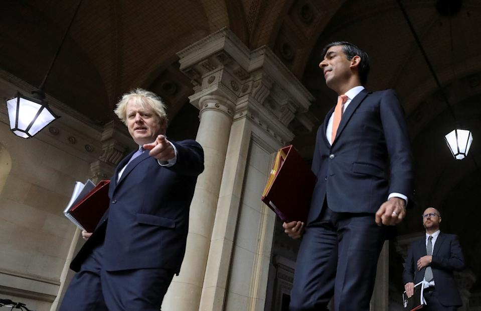 Britain's Prime Minister Boris Johnson and Chancellor of the Exchequer Rishi Sunak arrive for a Cabinet meeting, in London, Britain October 13, 2020. REUTERS/Simon Dawson