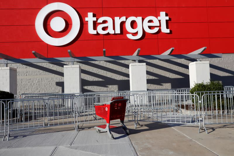 FILE PHOTO:  An empty shopping cart stands outside a target store during a Black Friday sales event in Westbury, New York