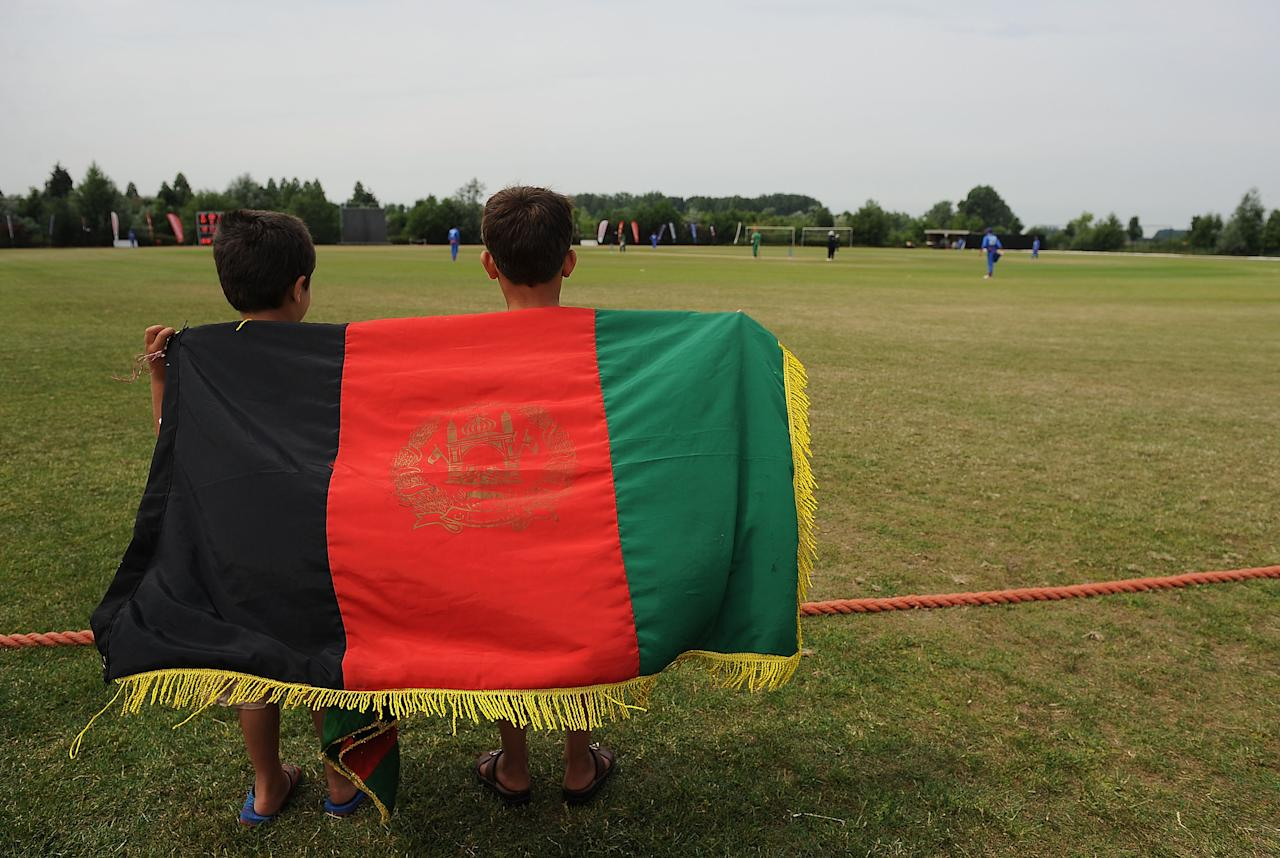 ROTTERDAM, NETHERLANDS - JULY 03:  Two young Afghanistan fans watch the match during the ICC World Cricket League Division One match between Ireland and Afghanistan at the Rotterdam VOC on July 3, 2010 in Rotterdam, Netherlands.  (Photo by Christopher Lee/Getty Images)