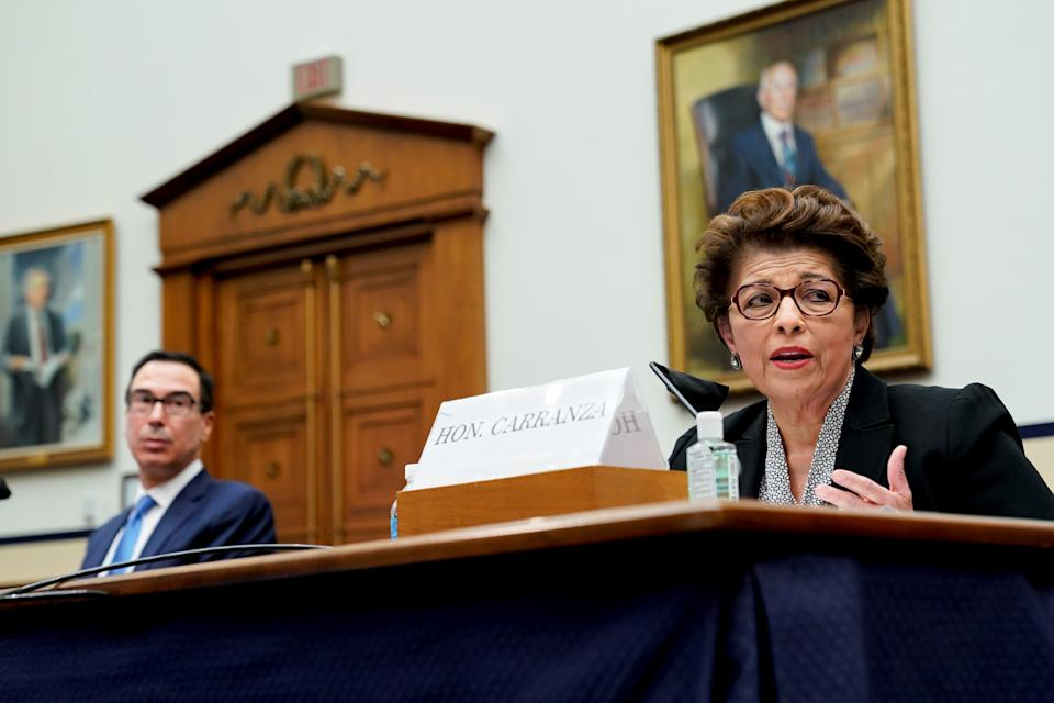 Jovita Carranza, administrator of the U.S. Small Business Administration (SBA), speaks as Steven Mnuchin, U.S. Treasury Secretary, left, listens during a House Small Business Committee hearing in Washington, DC, U.S., July 17, 2020. The committee hearing is looking into the Small Business Administration and Treasury pandemic programs. Erin Scott/Pool via REUTERS