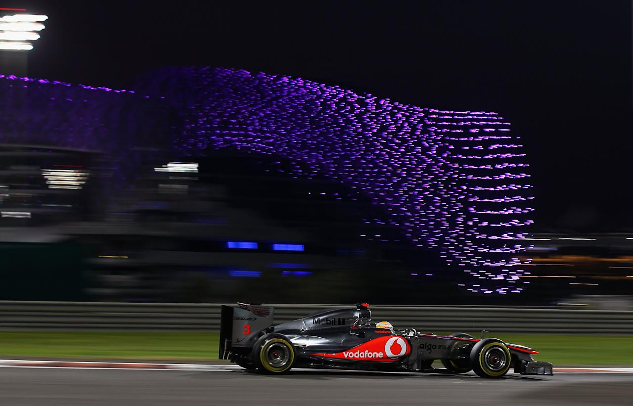 ABU DHABI, UNITED ARAB EMIRATES - NOVEMBER 12:  Lewis Hamilton of Great Britain and McLaren drives during qualifying for the Abu Dhabi Formula One Grand Prix at the Yas Marina Circuit on November 12, 2011 in Abu Dhabi, United Arab Emirates.  (Photo by Clive Mason/Getty Images)