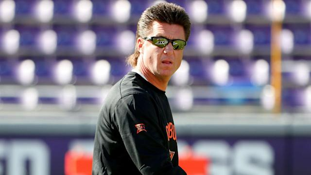 Tennessee turned its eyes to Oklahoma State's Mike Gundy after the Greg Schiano fiasco on Sunday. (Getty)