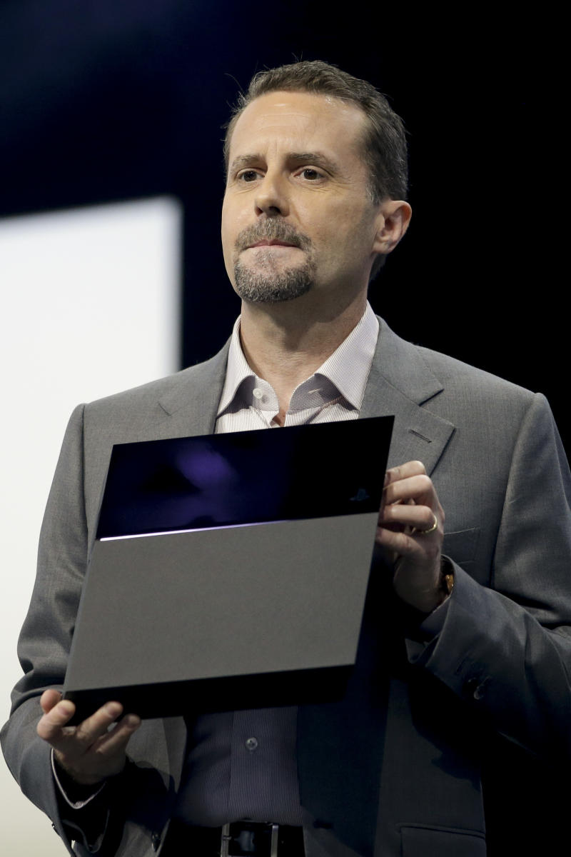 Sony Computer Entertainment president and CEO Andrew House introduces the new PlayStation 4 at the Sony PlayStation E3 media briefing in Los Angeles, Monday, June 10, 2013. Sony is giving gamers their first look at the PlayStation 4 and it's a rectangular black box, just like all the previous PlayStations. (AP Photo/Jae C. Hong)