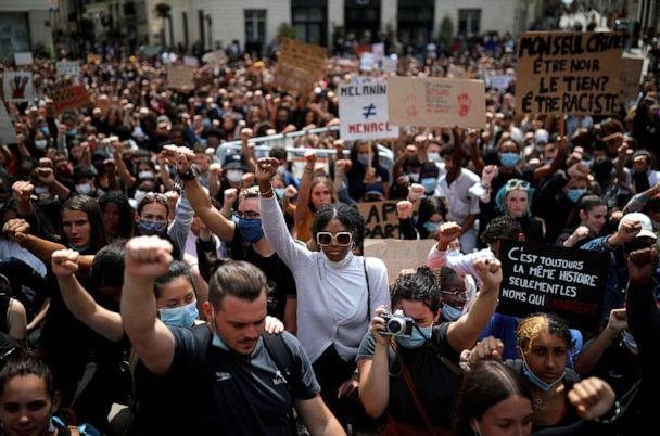 PHOTO: People raise their fists during a protest against police brutality and the death in Minneapolis police custody of George Floyd, in Nantes, France, June 8, 2020. (Stephane Mahe/Reuters)