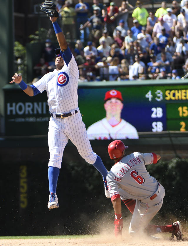 Cincinnati Reds' Billy Hamilton (6) steals second base as Chicago Cubs shortstop Addison Russell (27) takes the throw during the eighth inning of a baseball game Saturday, July 7, 2018, in Chicago. (AP Photo/David Banks)