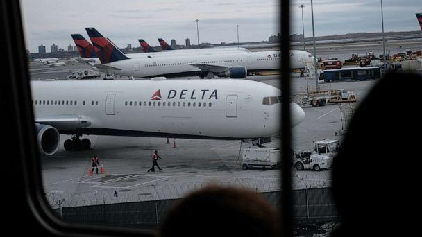 PHOTO: Delta airplanes sit on the tarmac at John F. Kennedy Airport on Jan. 31, 2020, in New York. (Spencer Platt/Getty Images)