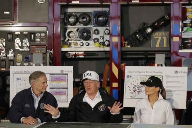 <p>President Donald Trump, flanked by Texas Gov. Greg Abbott and first lady Melania Trump speaks during a briefing on Harvey relief efforts, Tuesday, Aug. 29, 2017, at Firehouse 5 in Corpus Christi, Texas. (Photo: Evan Vucci/AP) </p>
