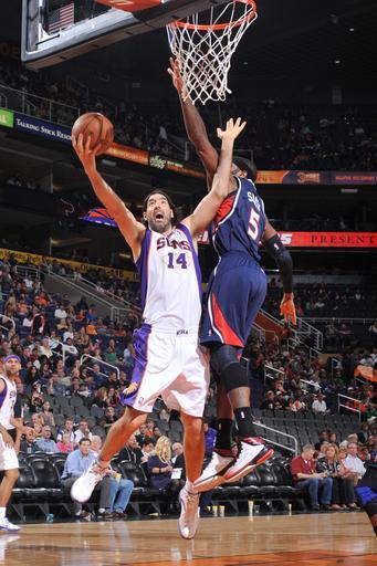 PHOENIX, AZ - MARCH 1: Luis Scola #14 of the Phoenix Suns drives for a shot against Josh Smith #5 of the Atlanta Hawks on March 1, 2013 at U.S. Airways Center in Phoenix, Arizona. (Photo by Barry Gossage/NBAE via Getty Images)