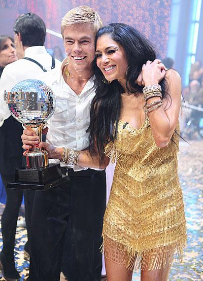 """In another reality showdown, Pussycat Doll Nicole Scherzinger and her pro partner Derek Hough were crowned Season 10 champions of """"Dancing with the Stars"""" Tuesday night. The 31-year-old isn't keeping her coveted mirror ball trophy though. """"I'm going to give it to my mom because she's the reason I really did this show,"""" Scherzinger told <i>Us Magazine</i>. """"This is for her!"""" Adam Larkey/ABC"""