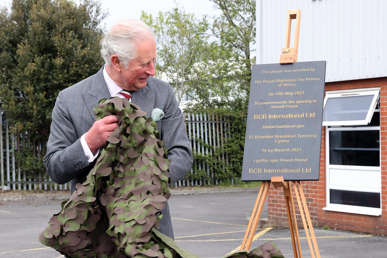 CARDIFF, UNITED KINGDOM - MAY 14: Prince Charles, Prince of Wales unveil a plaque to officially open the new headquarters of BCB at the end of his visit to the supplier of protective, medical and defence equipment, BCB International, on May 14, 2021 in Cardiff, United Kingdom. (Photo by Chris Jackson - WPA Pool/Getty Images)