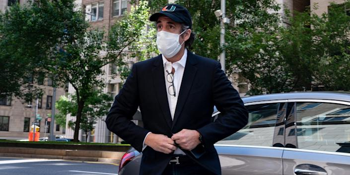 Michael Cohen is seen returning to his Manhattan home on May 21, 2020, after being granted a furlough from prison due to the coronavirus.