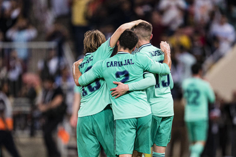 "JEDDAH, SAUDI ARABIA - JANUARY 08: Luka Modric (L), Daniel Carvaja (C) and Santiago Valverde of Real Madrid (R) celebrating Isco""u2019s goal during the Supercopa de Espana Semi-Final match between Valencia CF and Real Madrid at King Abdullah Sports City on January 8, 2020 in Jeddah, Saudi Arabia. (Photo by Eurasia Sport Images/Getty Images)"